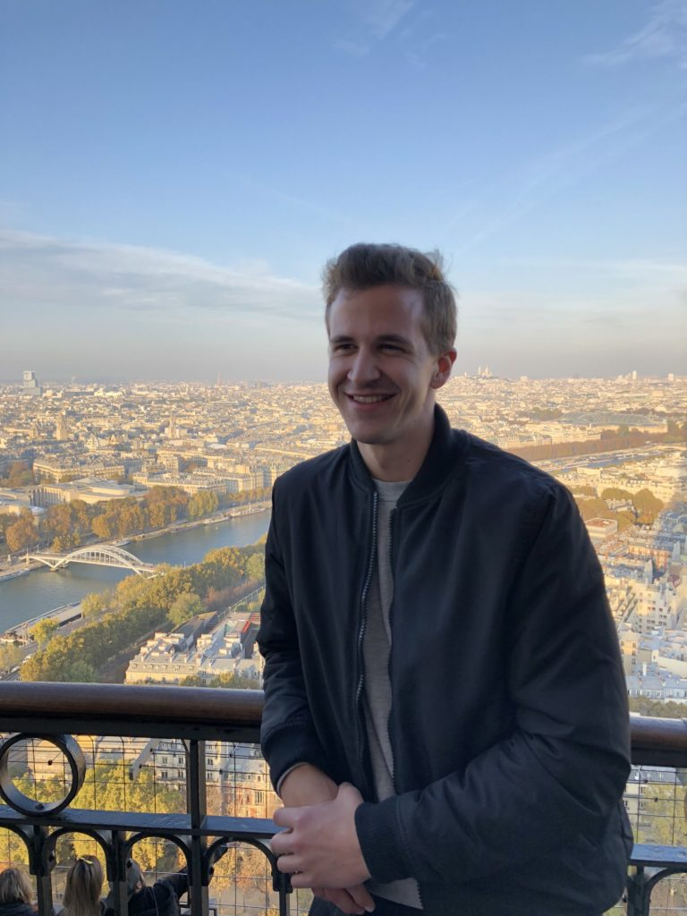 Am American student at the top of the Eiffel tower in Paris, France.