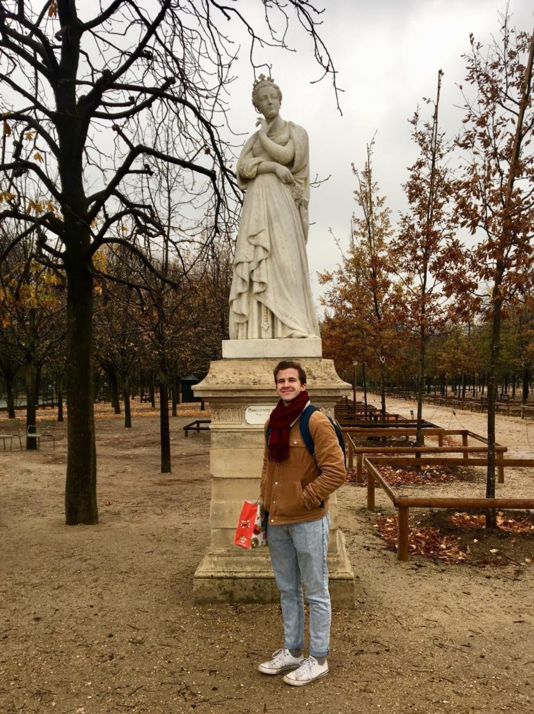 An American student standing in Luxemborg Gardens, Paris.
